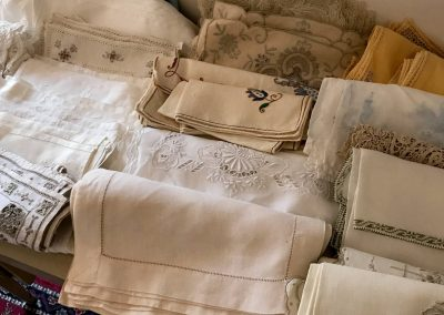 old linens on display - Fairfax and Page Estate Sales